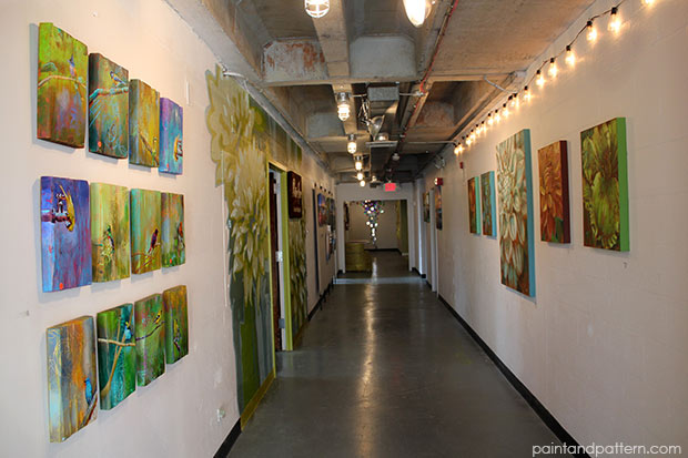 Ali Kay canvases on gallery wall