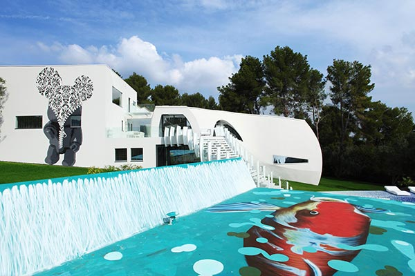 Colorful, unusual exterior for Spain's Casa Son Vida. Marcel Wanders wanted an unexpected twist in a modern setting.