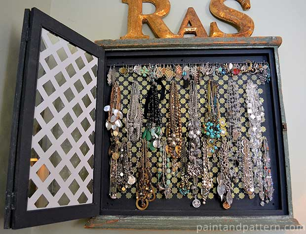 Vintage upcycled jewelry display cabinet with Moroccan stencils