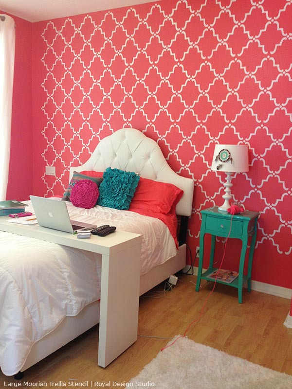 Moroccan stencil on a pink feature wall. Moorish Trellis stencil from Royal Design Studio