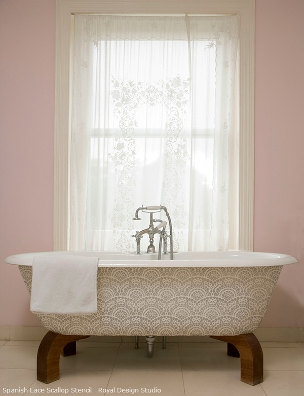 Stencil on a bathtub. Spanish Lace stencil from Royal Design Studio