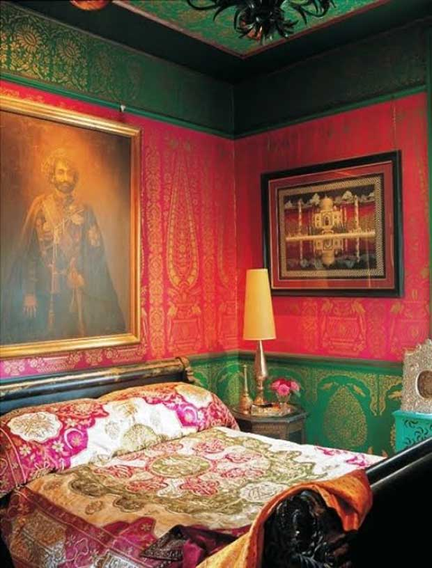 Colorful bedroom with royal wall patterns featured in Elle Decor