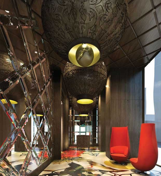 Mira Moon Hotel lobby in Hong Kong with moon-like light fixtures | Paint + Pattern