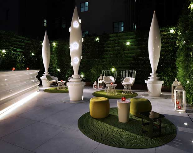Artistic outdoor setting at the Mira Moon Hote in Hong Kong | Paint + Pattern