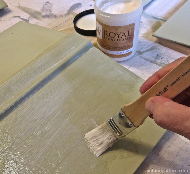 Using stencil size to create tack for the gold leaf | Stenciled and Gilded book cover DIY | Paint + Pattern