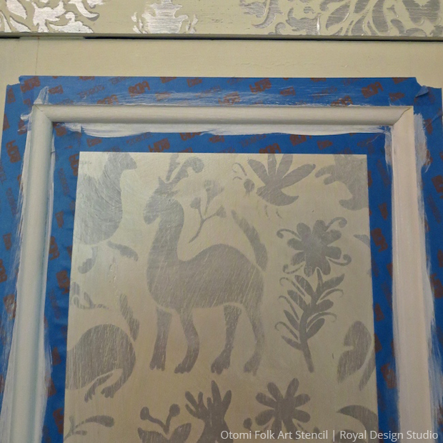 Masking with Pearl White Chalk Paint on Otomi Folk Art Stencil pattern for stenciled DIY cabinet   Paint + Pattern