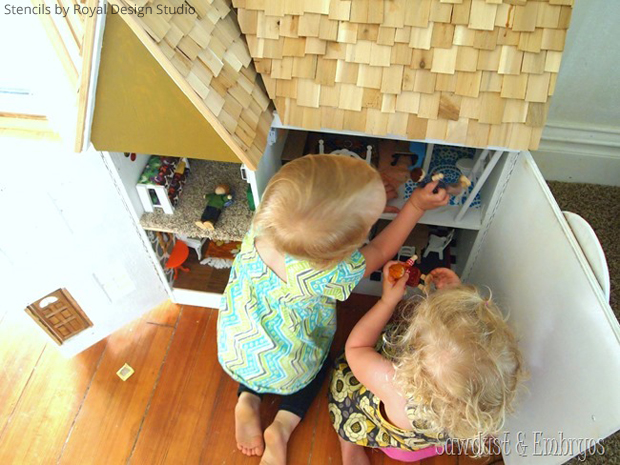 Playing with the stenciled dollhouse