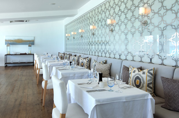 Panels in a restaurant with barbados palladium leaf and a white mica background designed by Miriam Ellner | Paint + Pattern