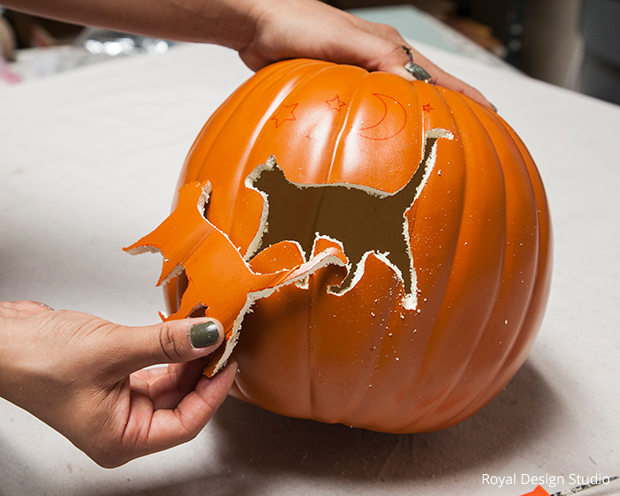 remove the carved piece gently from the pumpkin