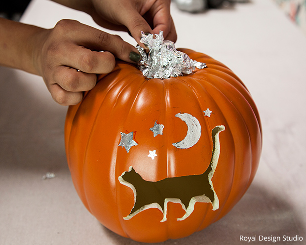 add silver leafing to the pumpkin