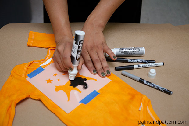 use stencils and tee juice pens for a Halloween cat onesies