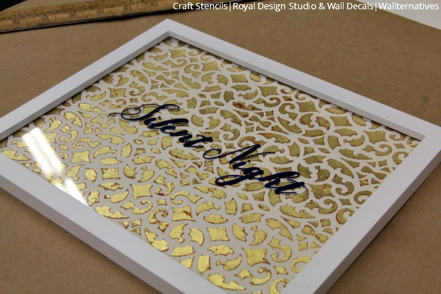 A gold christmas leaf wall art with stencils